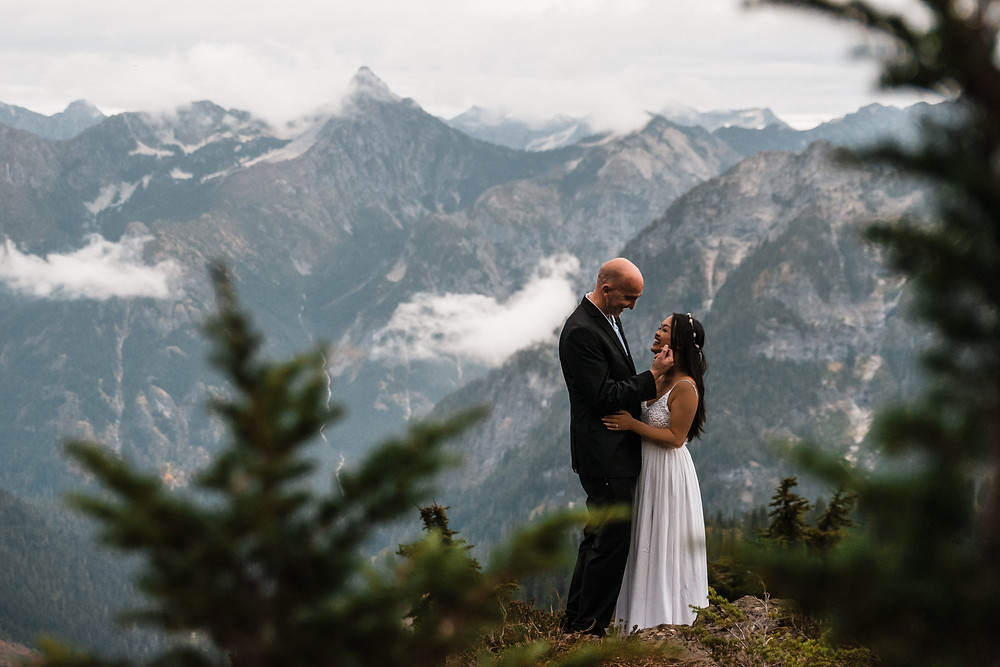 A couple on their adventure wedding day spend time exploring the mountains near Mount Baker