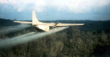 A U.S. Air Force aircraft spraying herbicides as part of a mission of Operation Ranch Hand during the U.S. war in Vietnam | Photo Credit: U.S. Air Force