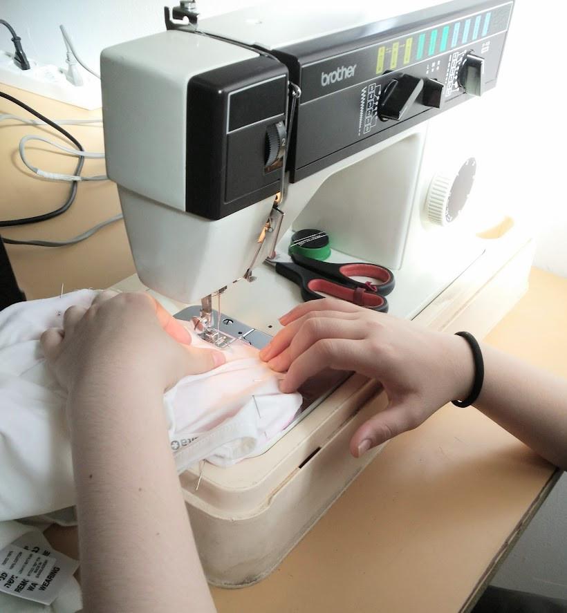 Children sewing sleeves