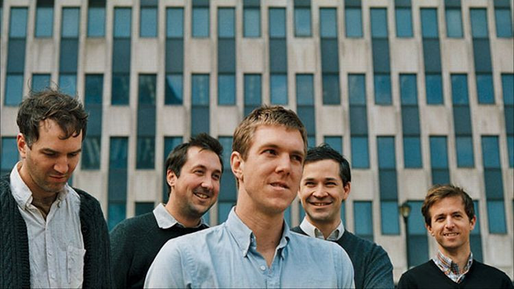 The Walkmen standing in front of a building