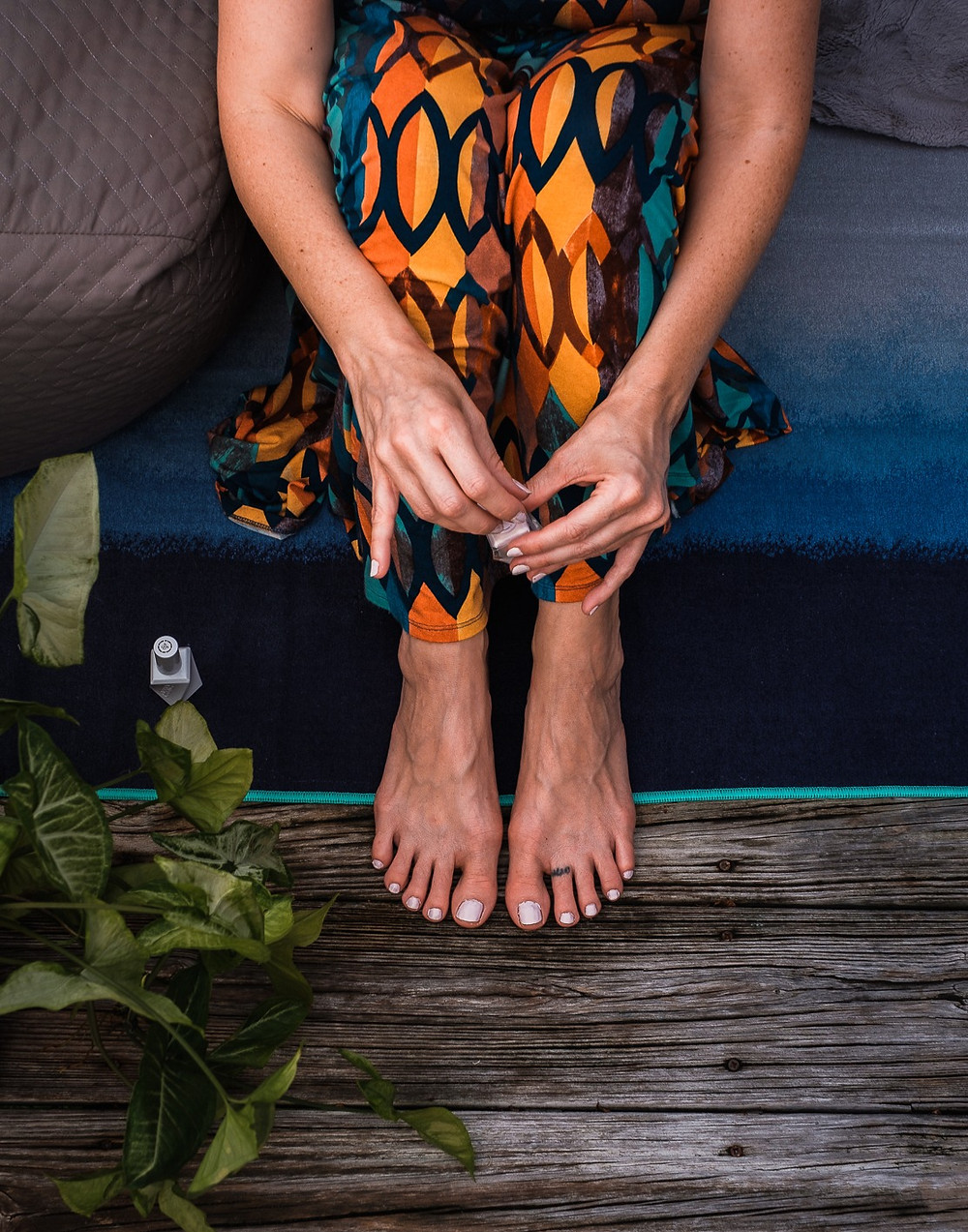 Woman with nail polish, self care DIY manicure and pedicure for personal brand photography.