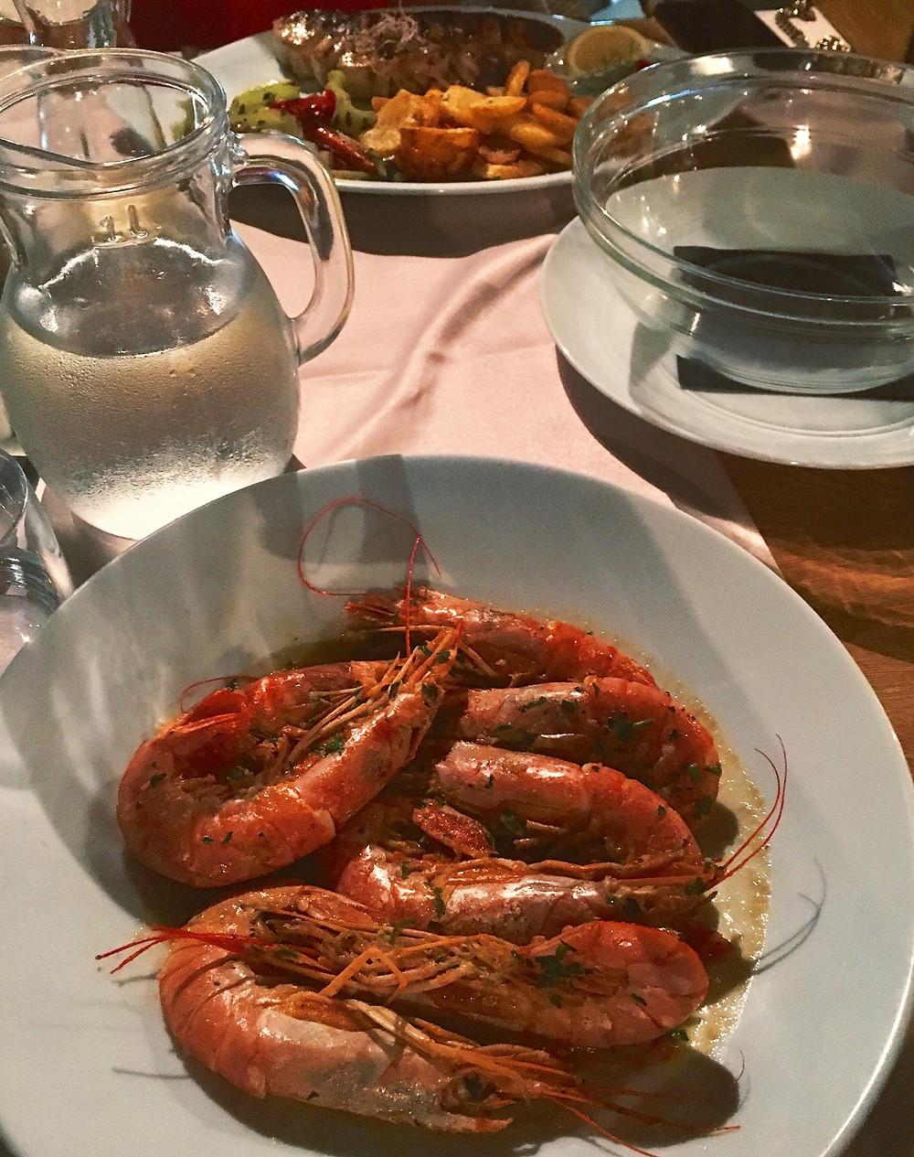 Buzara is traditional shrimp dish prepared in restaurant Kamena in Tucepi near Makarska in Croatia