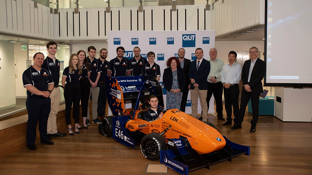 Some of QUT Motorsport team members with the Vice-Chancellor and President, Professor Margaret Sheil, Mark Boradmeadow, Dr. David Holmes, Yuantong Gu, Geoff Walker & Stephen Kajewski