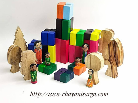 Building creativity with 64 piece wooden pyramid blocks