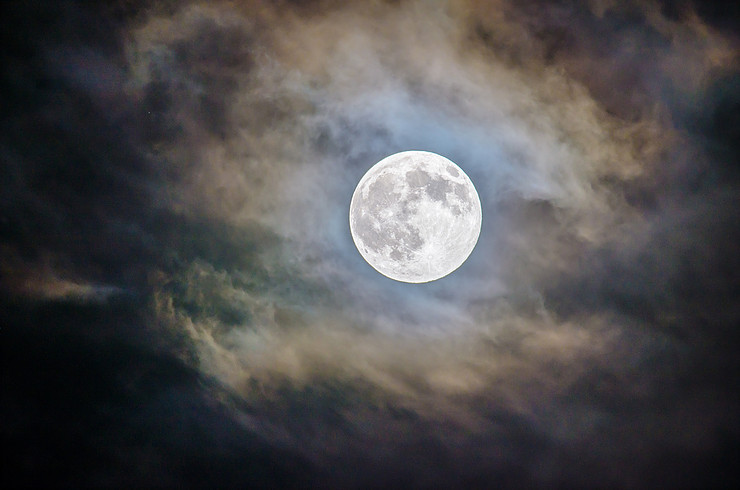 Full moon coming through clouds