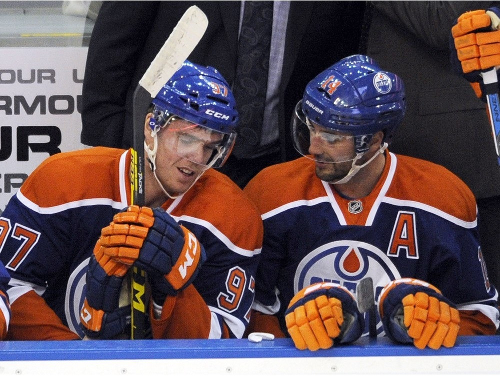 Connor McDavid and Jordan Eberle share notes on the bench