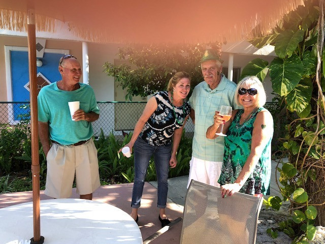 Photos of guests in green around pool