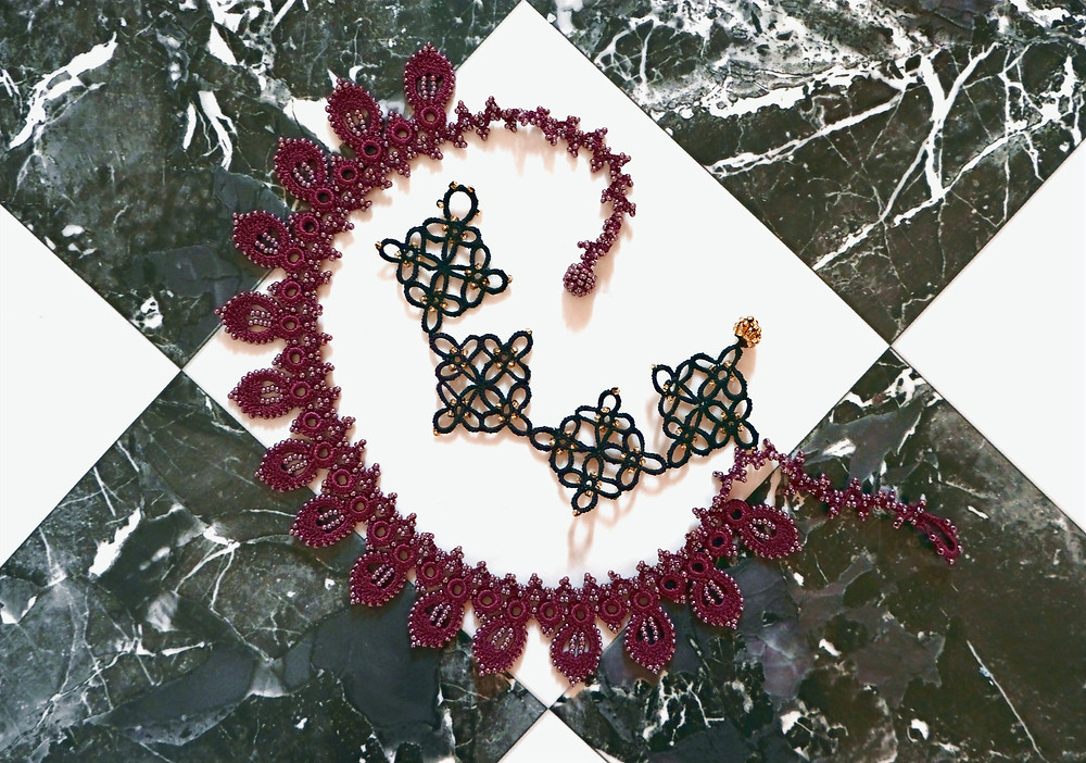 A burgundy lace necklace and a black bracelet