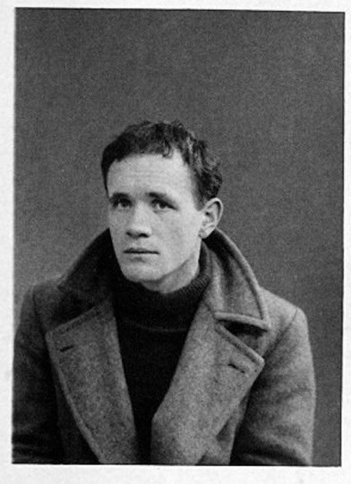 A man in a dark jumper and a winter coat