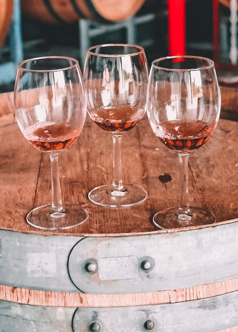 Summer rosé wine at a winery on a wine barrell