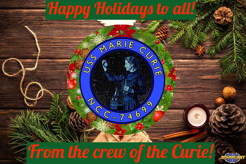 A holiday greeting card with the USS Marie Curie logo front and center.