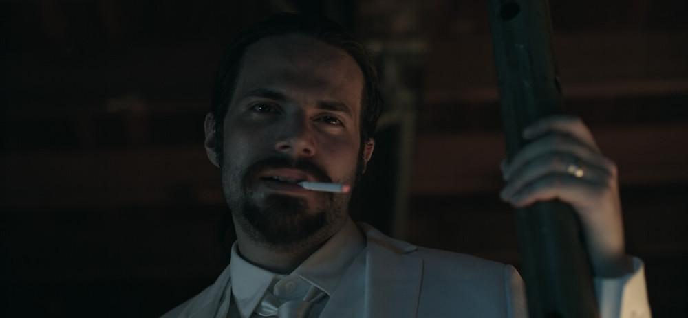 Still from Dual Action showing protagonist Joel Bernard.