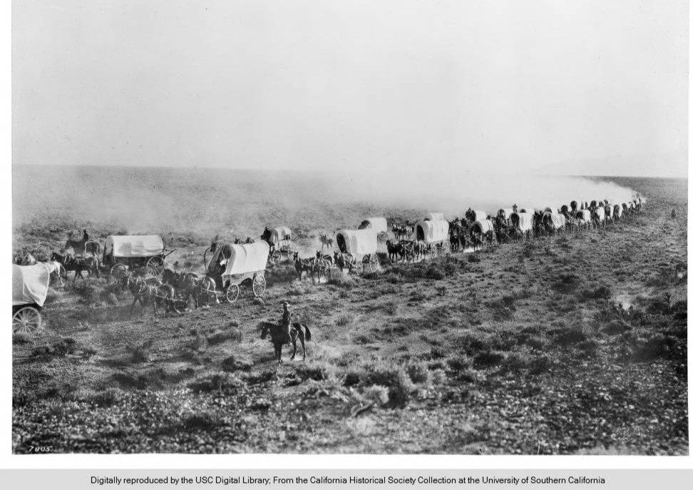Train of covered wagons on the Santa Fe Trail