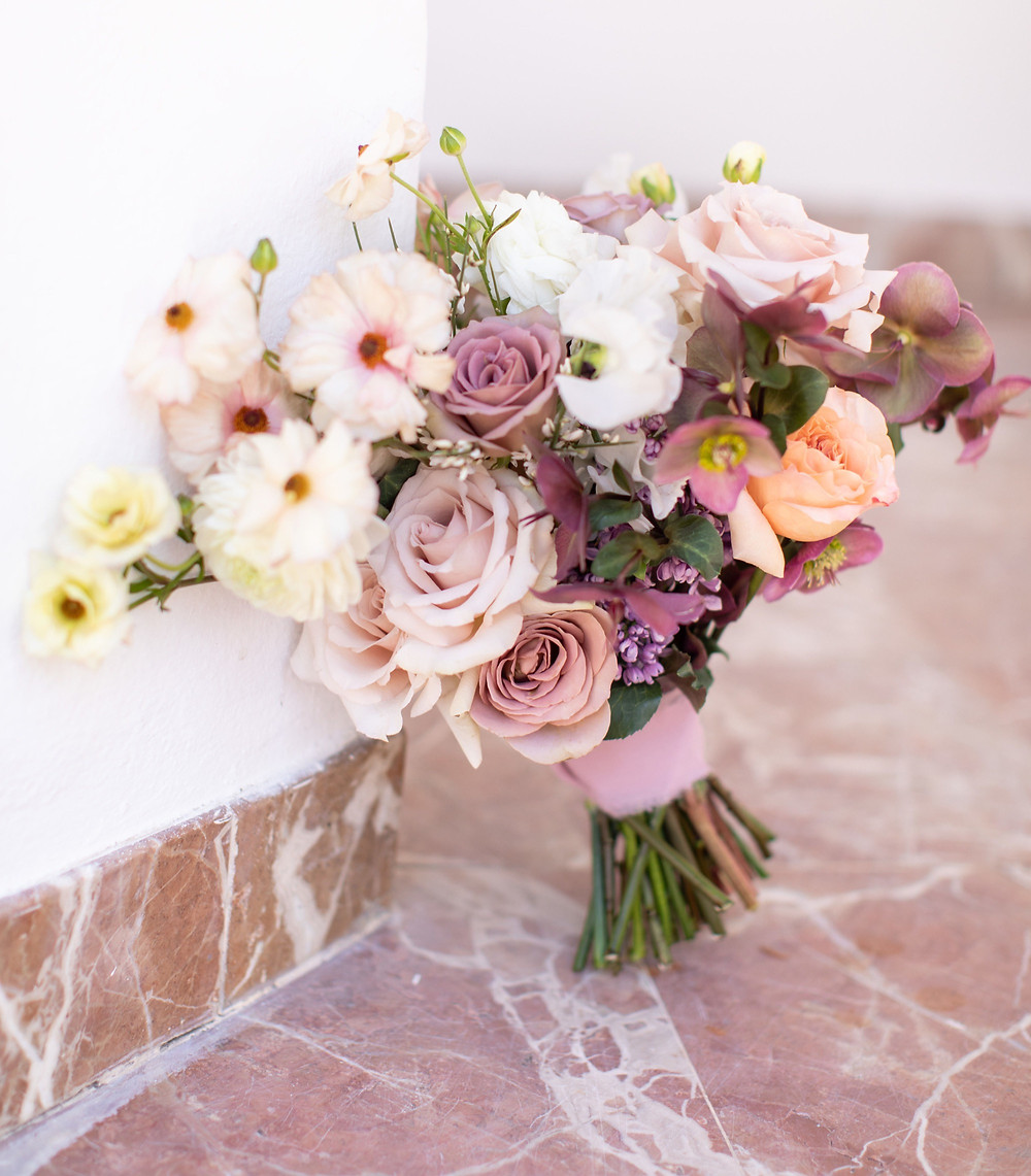 Beautiful bridal bouquet with perfect Spring time color palette and flowers, butterfly ranunculus, lilac, sweet peas, and hellebores for Rancho Las Lomas Wedding, made by San Diego Wedding Florist, Le Champagne Projects