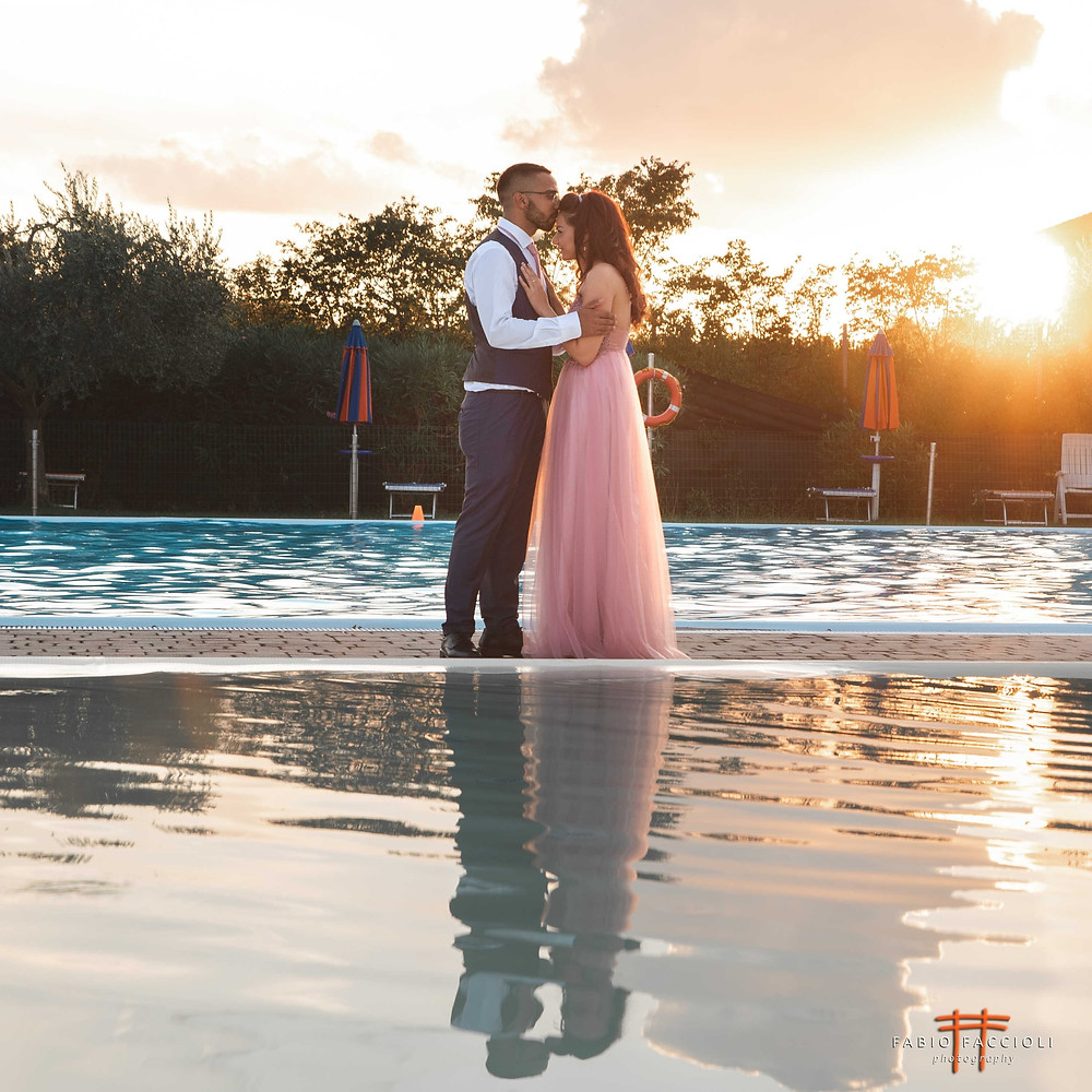 Swimming Pool at sunset in Sirmione. Engagement Photoshoot
