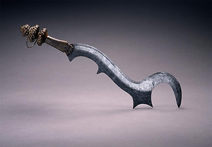 a Central African sword created by the Ngombe people. It was reputedly used for executions and later took on the role as a prestige item.