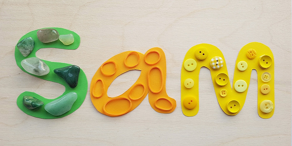 green, orange and yellow loose parts