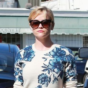 Reese Witherspoon pairs a higher contrast print with a bold lip