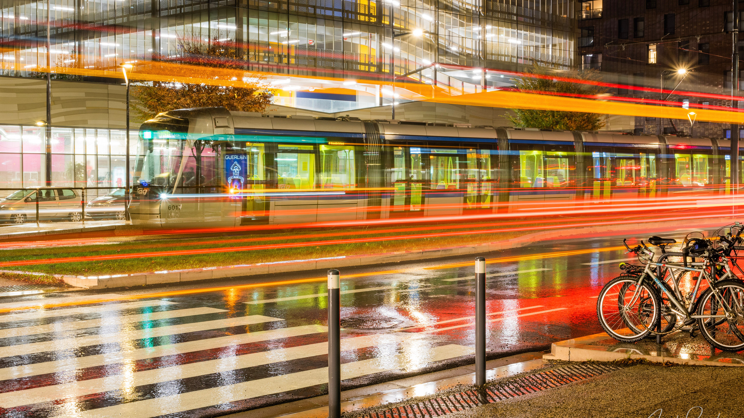 A tram from Grenoble on a rainy night