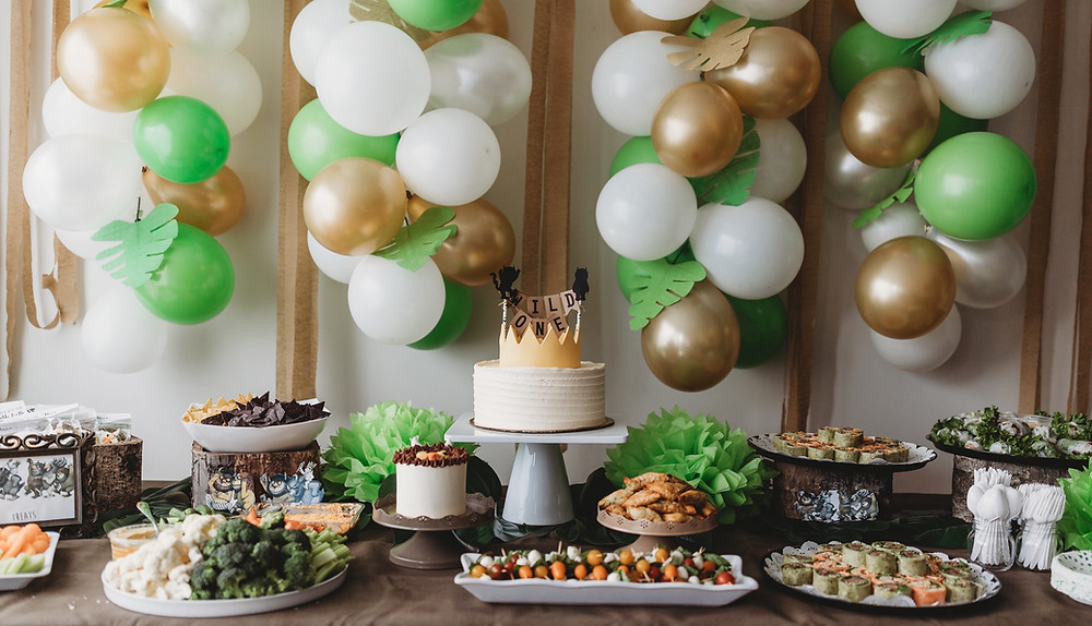 birthday party table with cake and decorations