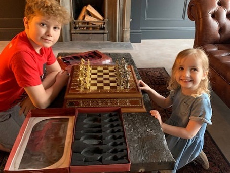 Learning new skills. Chess with her older brother. Alexia-May Nursery
