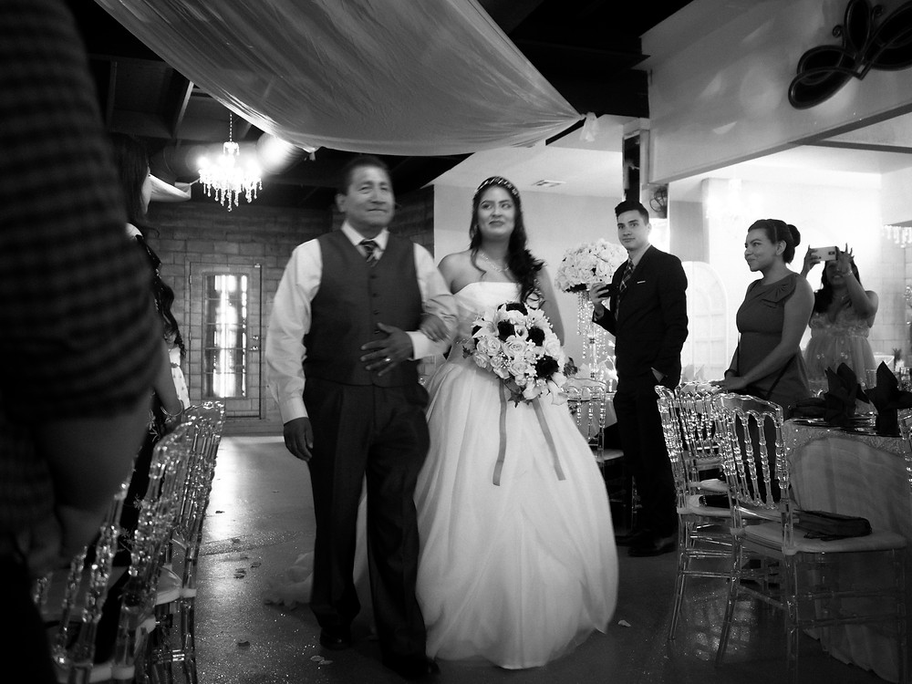 Father and bride walking down the aisle together