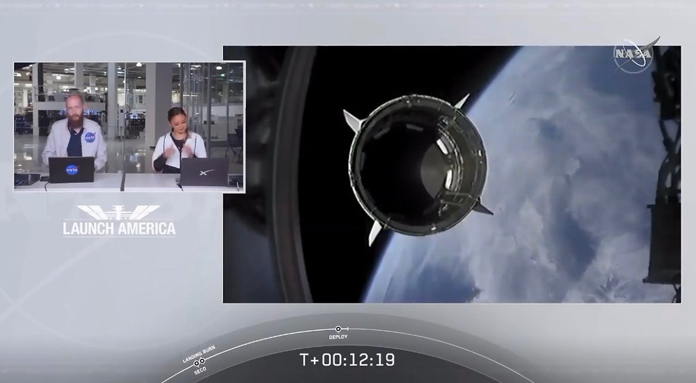 SpaceX Dragon breaking away from a rocker stage over earth