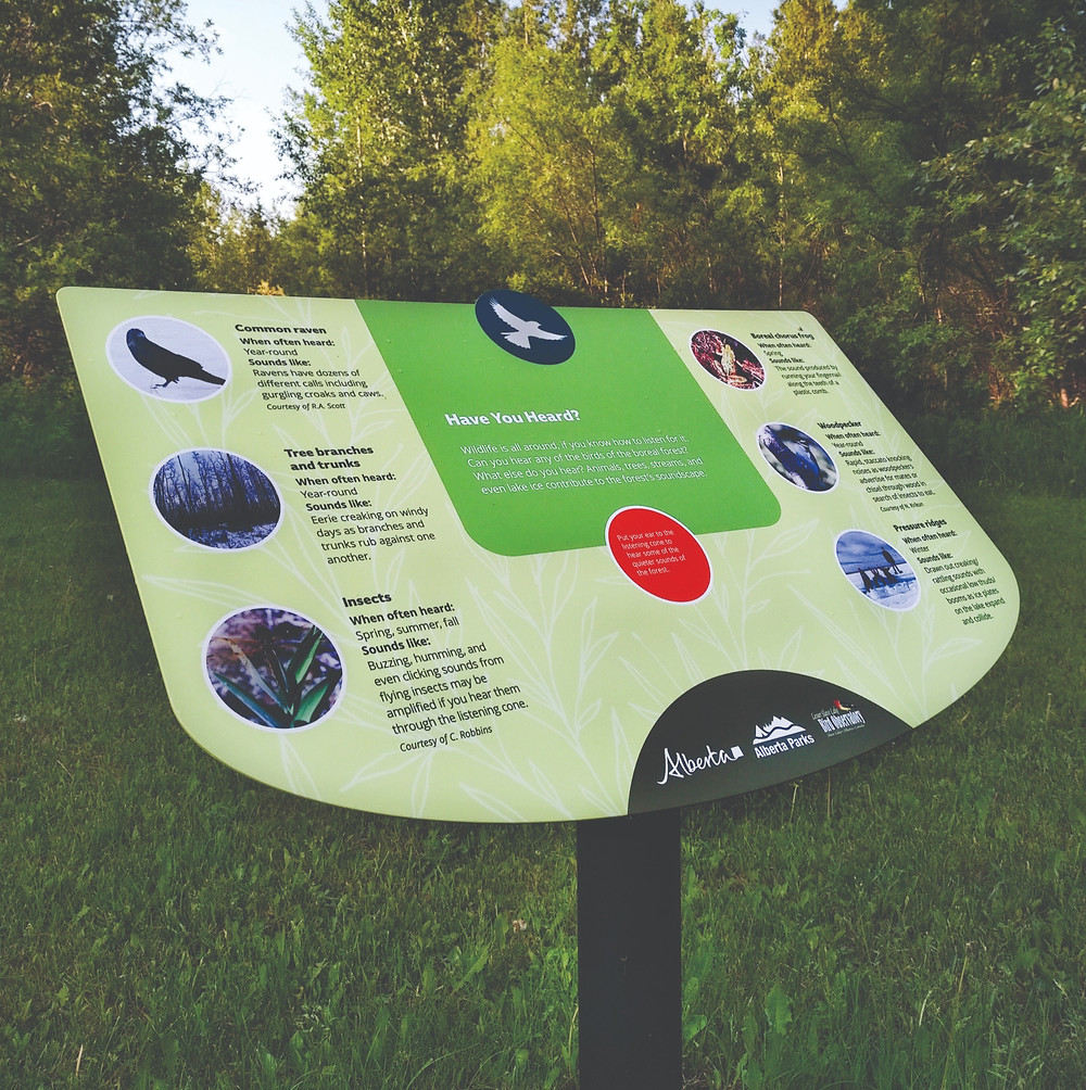 green trail sign with birds on custom powder-coated graphics
