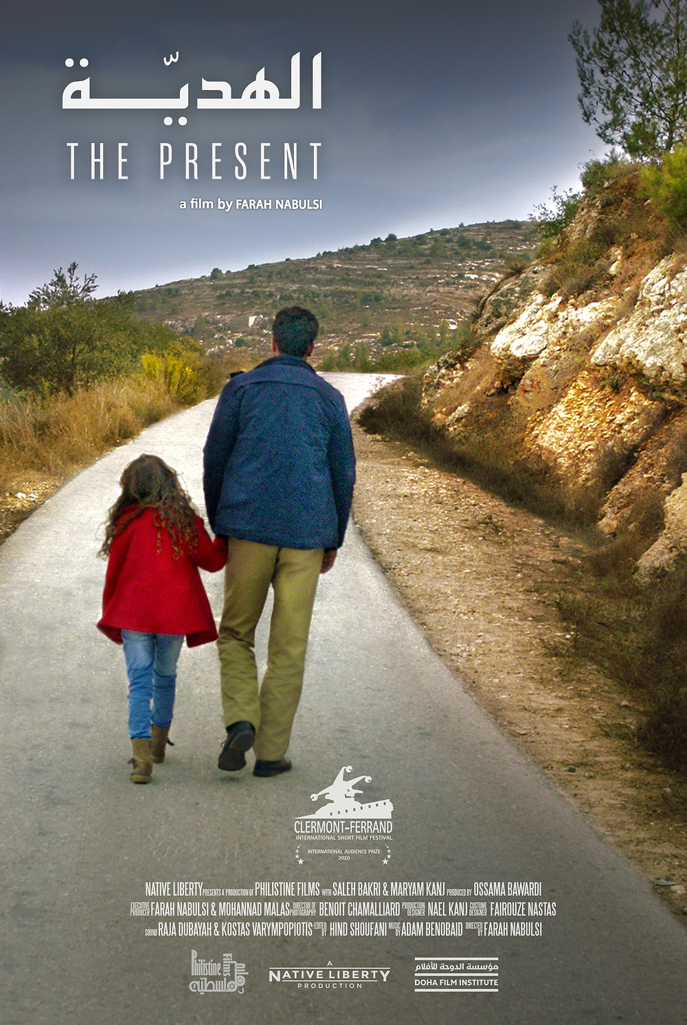 Yusef and Yasmine walking on the road.