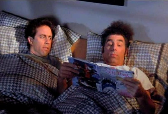 Seinfeld reading in bed