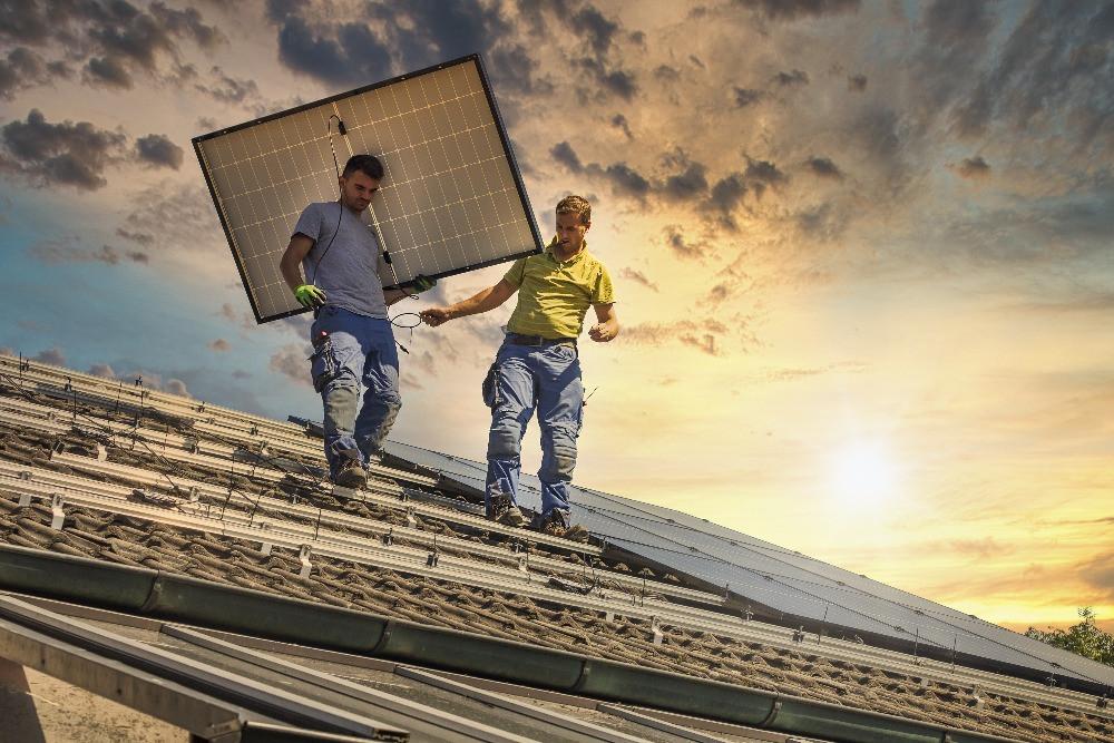Contractors installing solar PV panels