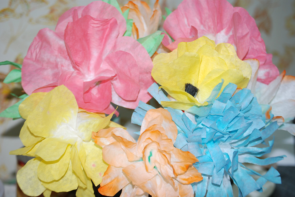 Pastel aper flowers, made from coffee filters and leftover Easter egg dye.