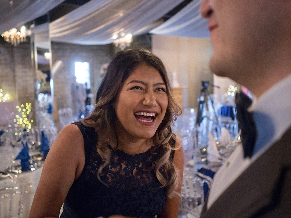 The sister of the bride, laughing at something the groom must have said