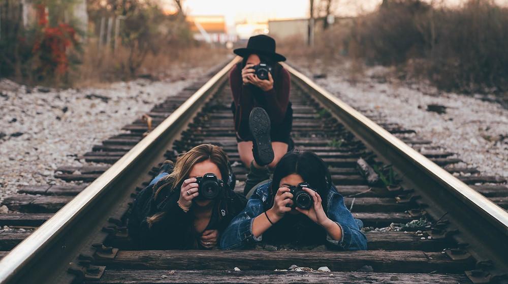 Three Professional Female Photographers on a train track