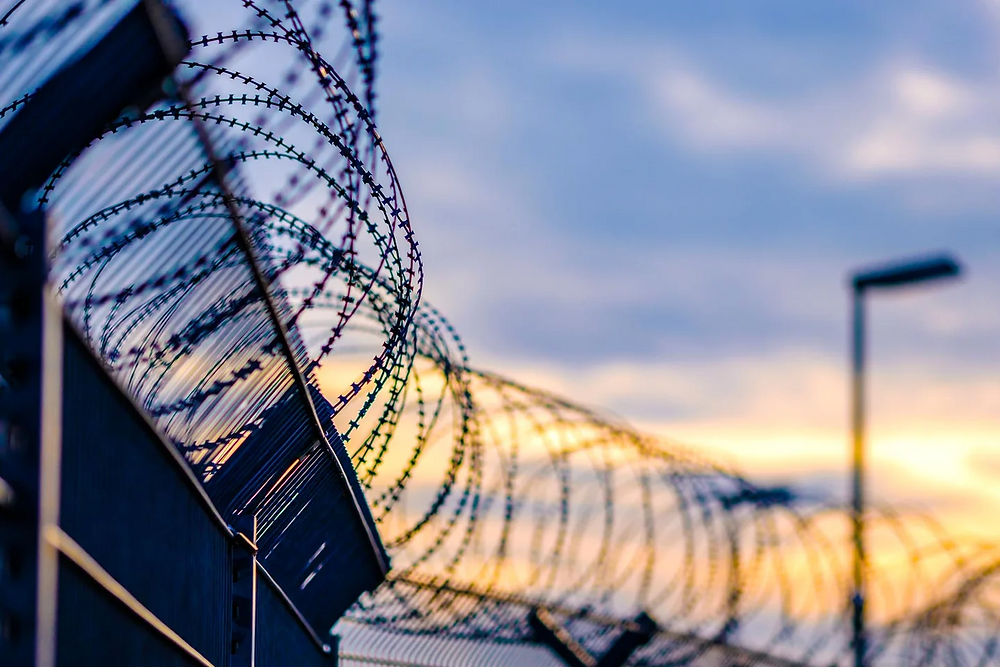 Wire on fencing of prisons.