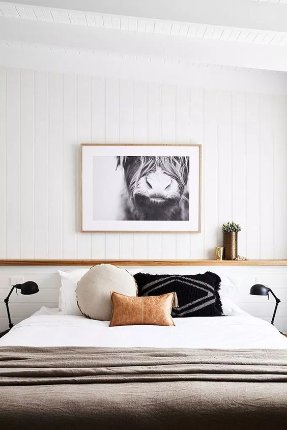 Cowboy Aesthetic Interiors bedroom with cow poster