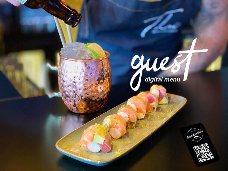 Cocktail Moscow Mule et Assiette de Sushis. Guest menu est une application qui permet de consulter la carte du restaurant en présentant les photos des cocktails, plats, et leurs allergènes.