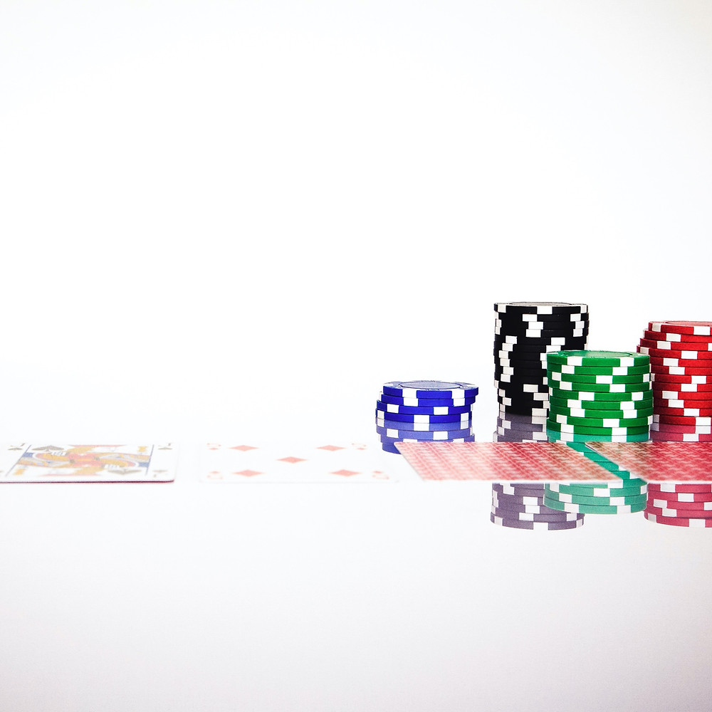 poker chips and cards, investment risk