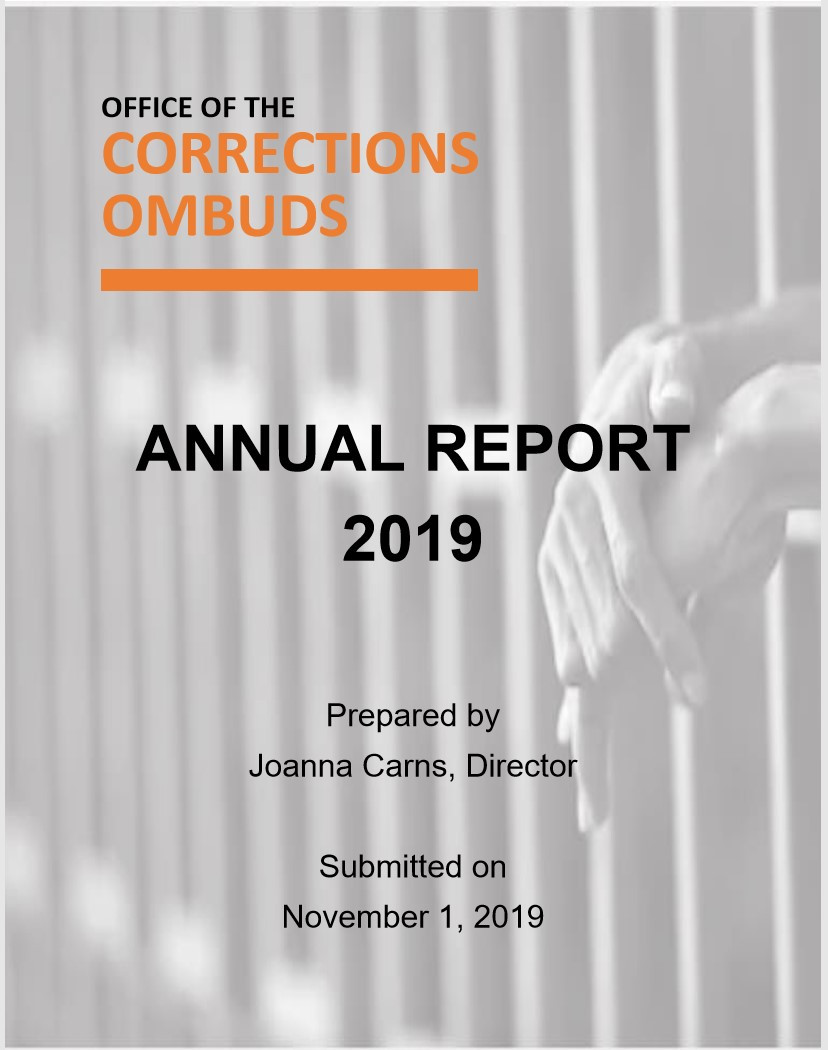 the text of the report cover overlays a photograph of hands resting on prison bars