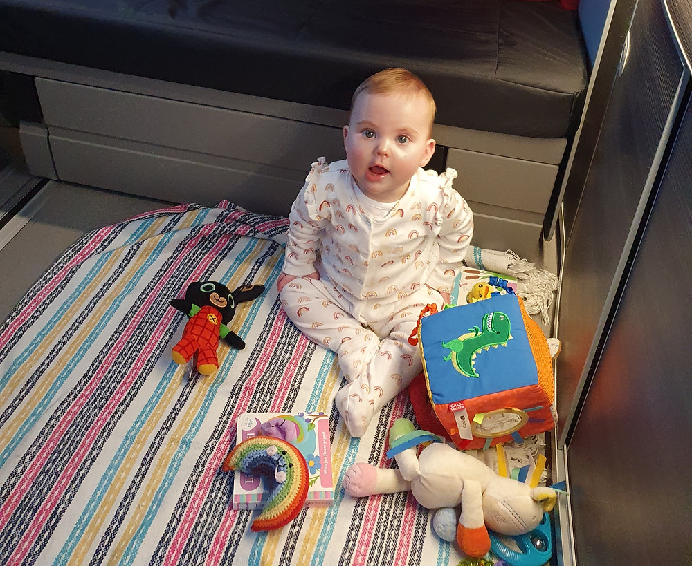 Baby playing in a campervan