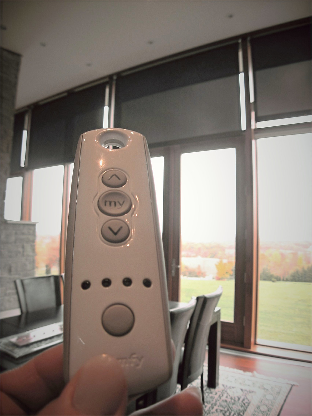 A hand held remote. Just one of the many options for operating motorized shades.