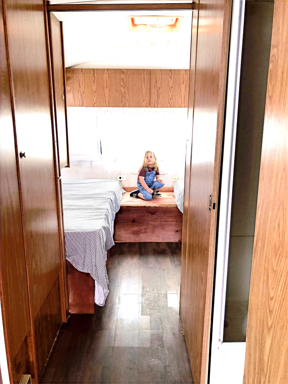 bedroom inside of an airstream travel trailer