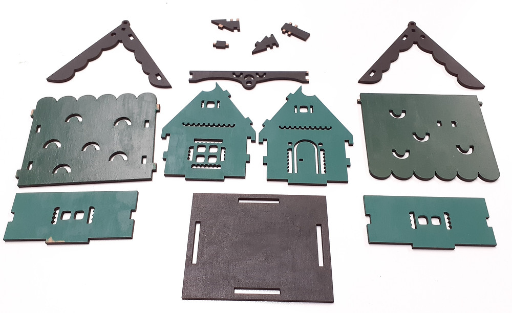 Painted pieces of miniature house kitset