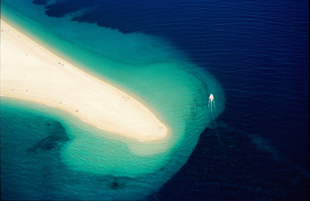 Aerial view of Golden Horn pebble beach in Croatia near Makarska Riviera