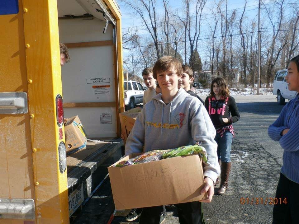 Teens from our homeschool group helping carry food at the bread of life food bank located at strong tower church in forest hill maryland.