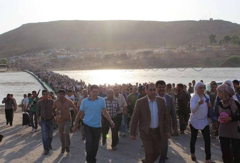 Thousands of people flowed from Syria across the Peshkhabour border crossing into Iraq's Dohuk Governorate © UNHCR/G.Gubaeva