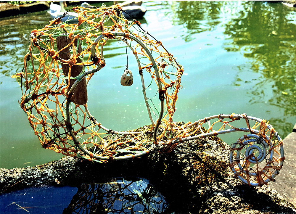 Metal frame netting and sculptures jetsam from the sea