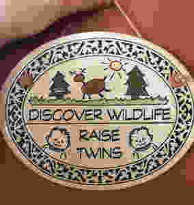 Discover wildlife raise twins plaque