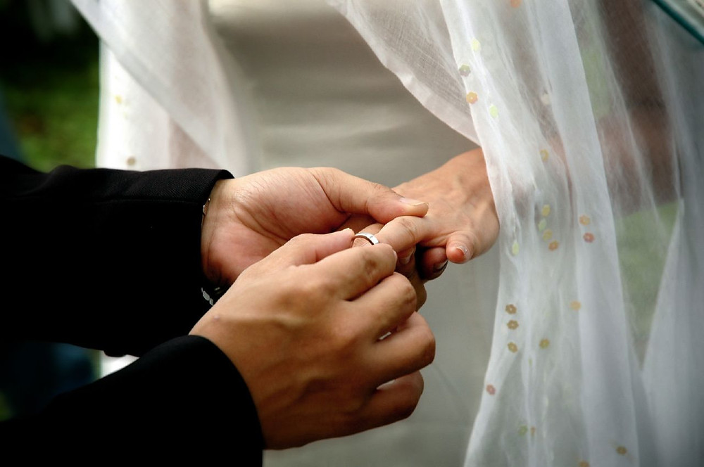 """(""""Exchanging rings"""" by James chew/ Flickr images)"""