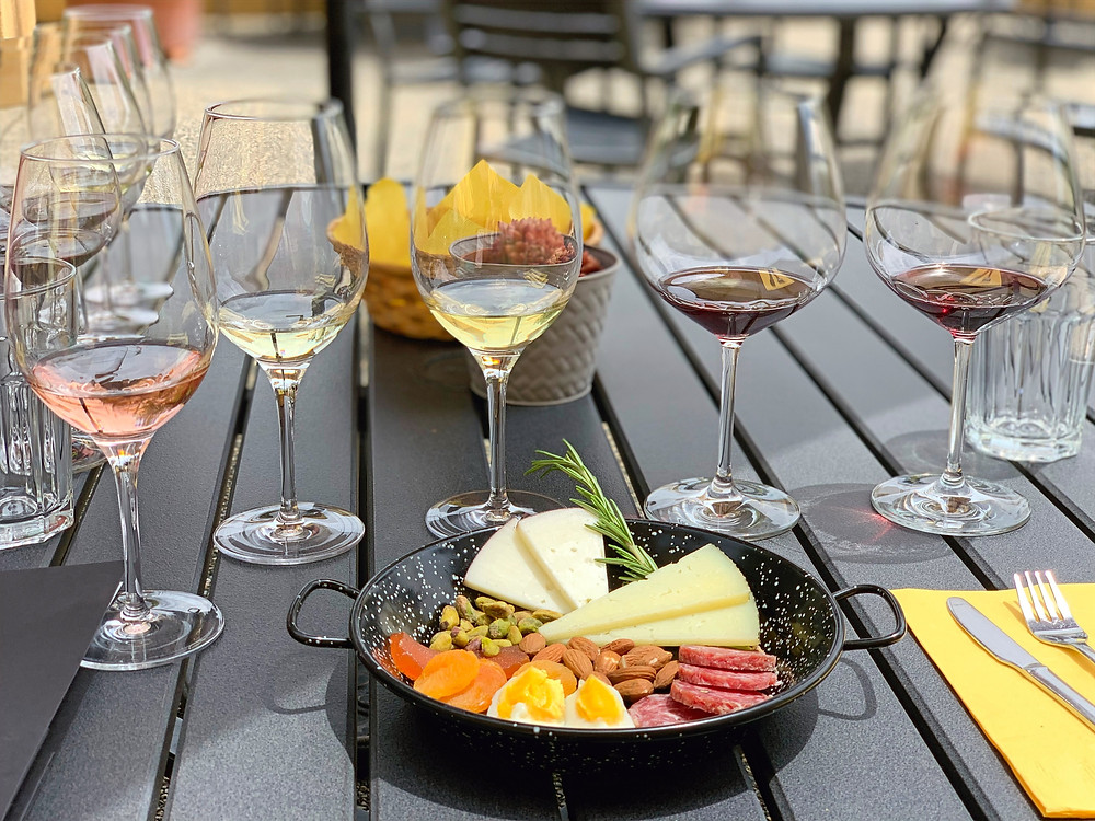 Marimar Estate wine flight with tapas on their sprawling patio. Photo by Blonde Tasting